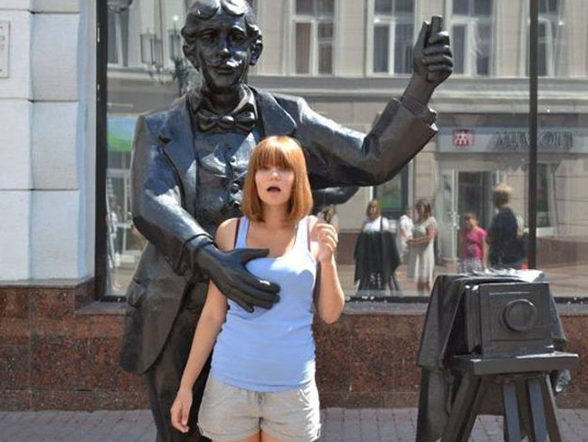 statues attacking people.