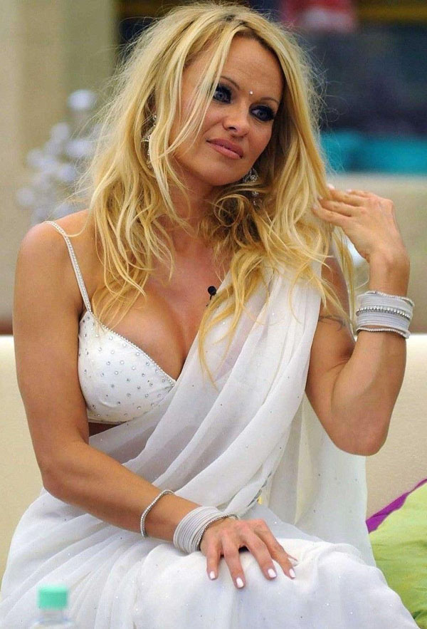 Pamela Anderson sexiest pictures from her hottest photo shoots. (1)