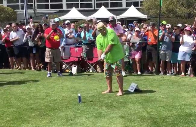 john daly drives golfball off beer can.