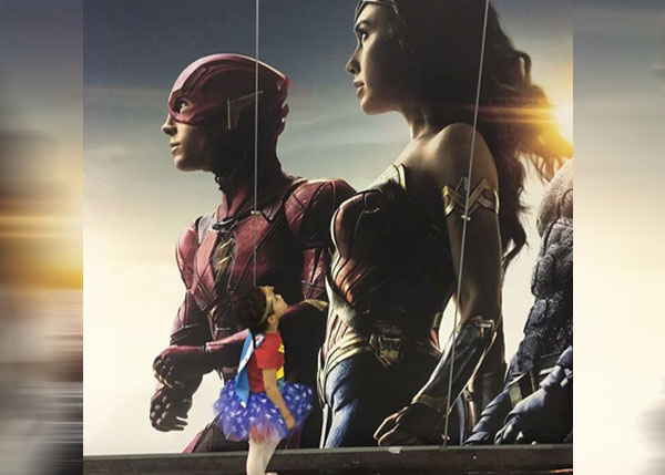 Little Ladies Who Were Empowered By Wonder Woman and posing with the movie poster. (28)