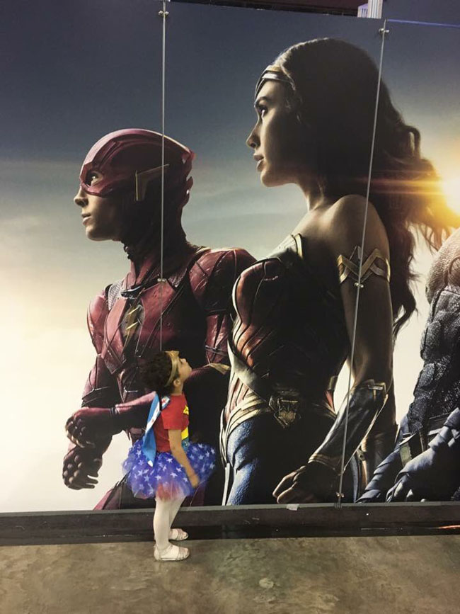 Little Ladies Who Were Empowered By Wonder Woman and posing with the movie poster. (27)