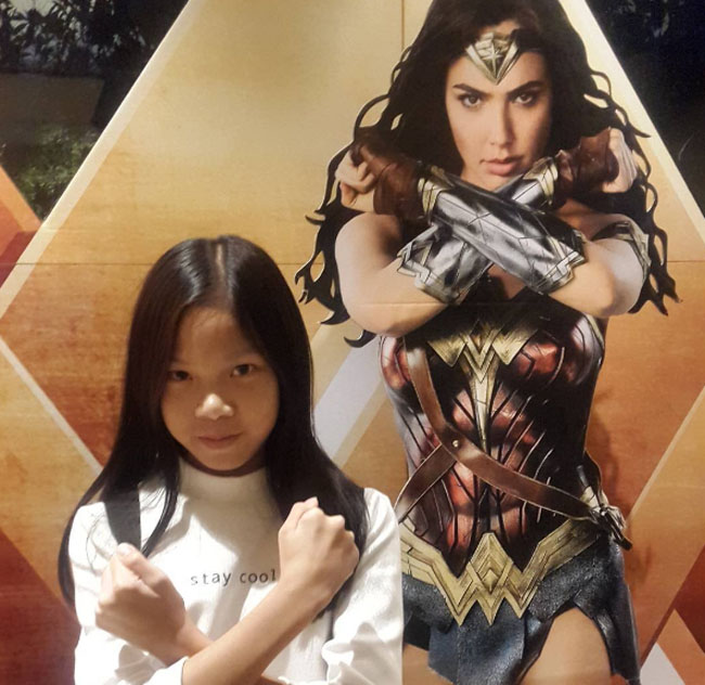 Little Ladies Who Were Empowered By Wonder Woman and posing with the movie poster. (26)