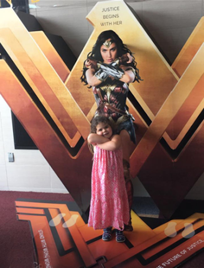 Little Ladies Who Were Empowered By Wonder Woman and posing with the movie poster. (24)
