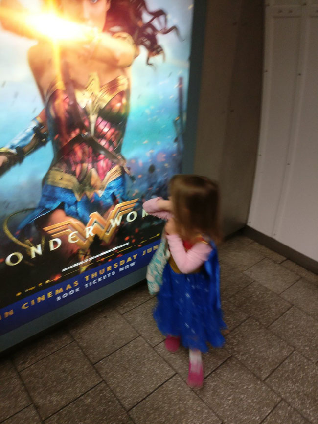 Little Ladies Who Were Empowered By Wonder Woman and posing with the movie poster. (23)