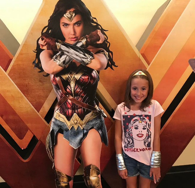 Little Ladies Who Were Empowered By Wonder Woman and posing with the movie poster. (21)