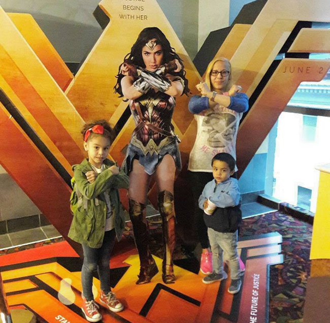 Little Ladies Who Were Empowered By Wonder Woman and posing with the movie poster. (17)