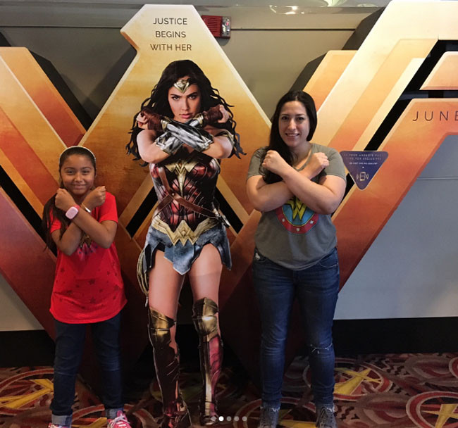 Little Ladies Who Were Empowered By Wonder Woman and posing with the movie poster. (16)