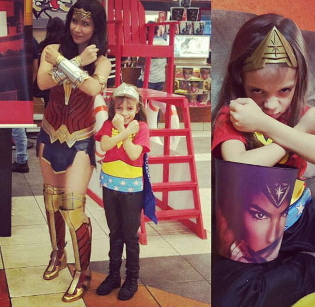 Little Ladies Who Were Empowered By Wonder Woman and posing with the movie poster. (15)