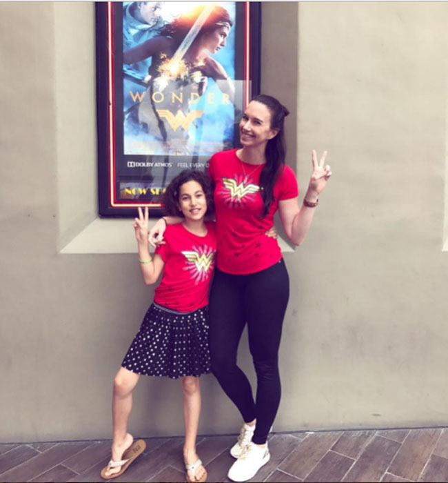 Little Ladies Who Were Empowered By Wonder Woman and posing with the movie poster. (8)