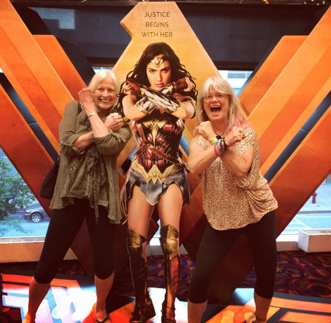Little Ladies Who Were Empowered By Wonder Woman and posing with the movie poster. (5)