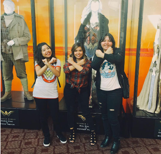 Little Ladies Who Were Empowered By Wonder Woman and posing with the movie poster. (4)