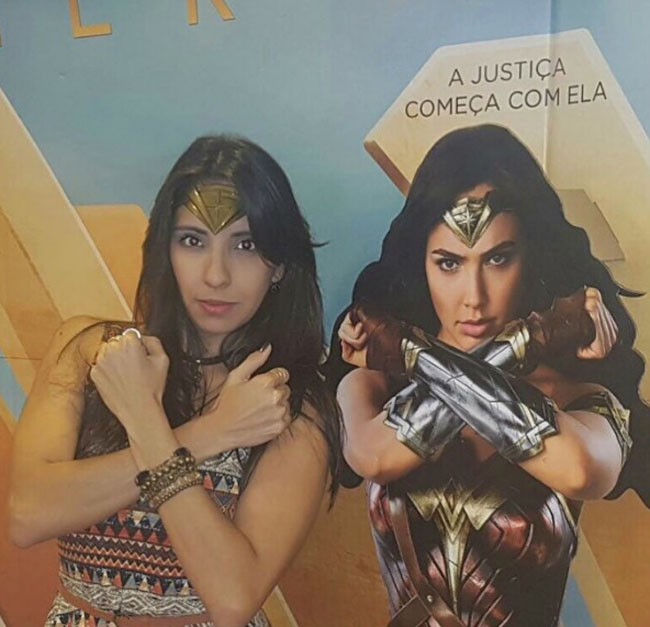 Little Ladies Who Were Empowered By Wonder Woman and posing with the movie poster. (3)