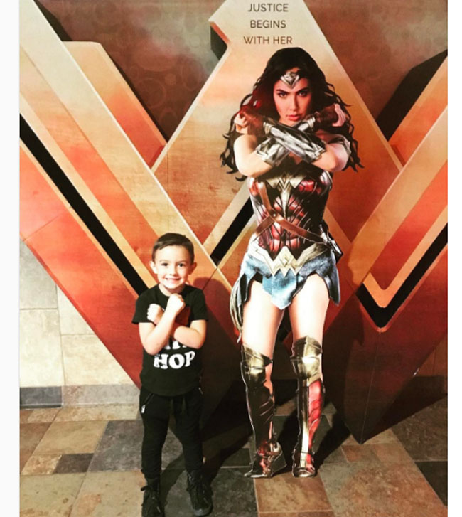 Little Ladies Who Were Empowered By Wonder Woman and posing with the movie poster. (1)