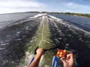 Dude Solving A Rubix Cube While Water Skiing.