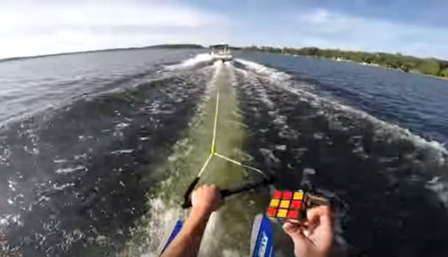 Dude Solving A Rubik's Cube While Water Skiing.