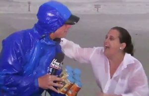 Texas Woman Gives Reporter Beers During Live Hurricane Coverage.